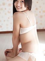 Mayumi Yamanaka Asian smiles while undressing with erotic moves